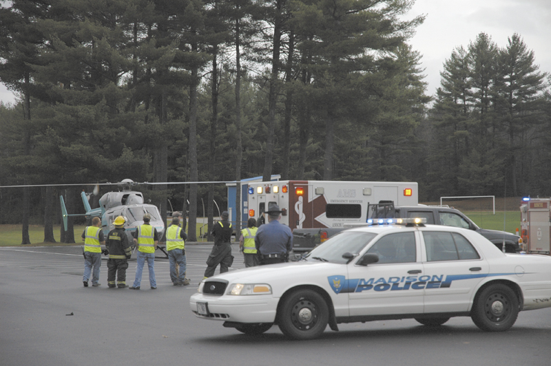 A LifeFlight helicopter arrives Wednesday afternoon at a Madison High School parking lot to airlift Kerry Hebert, of Starks, to Central Maine Medical Center in Lewiston. Herbert was shot Wednesday in a hunting-related incident, according to police.
