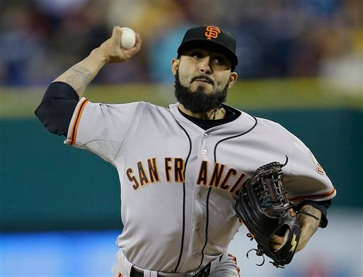 San Francisco Giants' Sergio Romo throws during the ninth inning of Game 3 of the World Series against the Detroit Tigers Saturday in Detroit. MLB