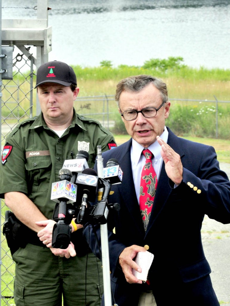 File photo by David Leaming Department of Public Safety Spokesman Steve McCausland, right, gives an update on the extensive search for Ayla Reynolds along the Kennebec River in this file photo from July 17. At left is Lt. Kevin Adam of the Maine Warden Service.
