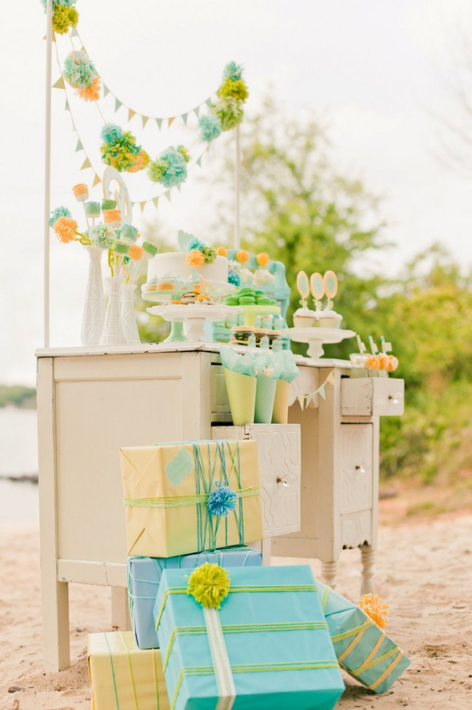 """Designers and stylists Maureen Anders and Adria Ruff used a palette of mint, aqua, yellow and lime green for a gender-neutral baby shower. They incorporated handmade elements like wool pompoms and used paper, marshmallows and cake decorations to create centerpiece """"flowers."""""""