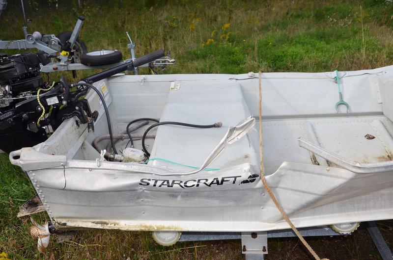 A 14-foot aluminum skiff shows damage from the fatal collision with a cabin cruiser near Littlejohn Island on Sept. 21.