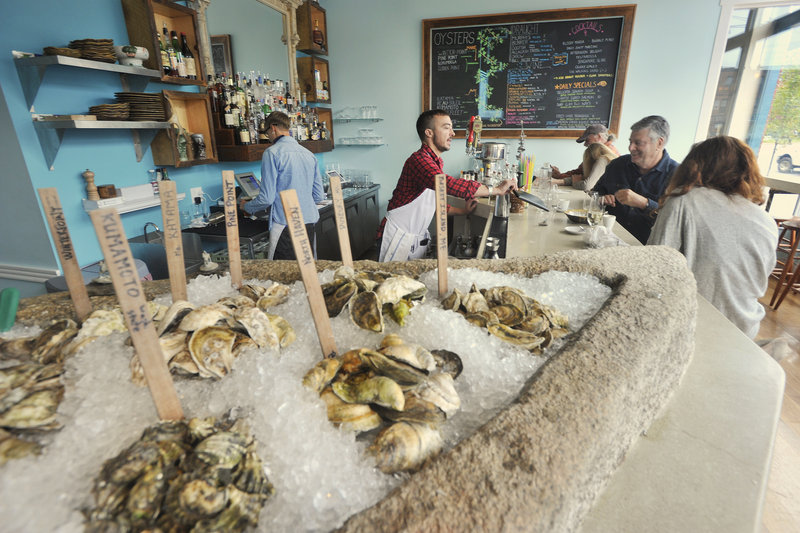 """At Eventide Oyster Co., wooden sticks mark the varieties like a bivalve garden plot. Diners can try a half- or full dozen ($15 and $27), grouped by """"Maine"""" and """"From Away,"""" accompanied by Mimosa Mignonette, Tomato Water or Horseradish Ice."""