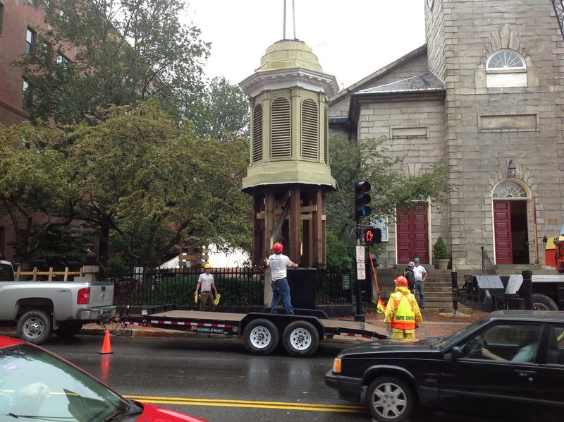 A section of the steeple of the historic First Parish Unitarian Universalist Church on Congress Street in Portland is lowered Wednesday. It will be restored this winter by steeplejacks in Vermont.