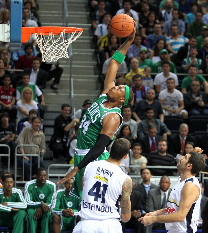 Paul Pierce goes for the dunk in a losing cause as the Celtics fell 97-91 to Fenerbahce Ulker in the NBA's first exhibition game Friday in Turkey.
