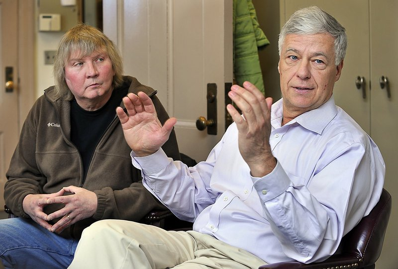 Millinocket Selectman Mark Marston, left, listens in April 2011 as Rep. Mike Michaud discusses his view of the situation with the closed Katahdin Paper Mill in East Millinocket, his hometown.