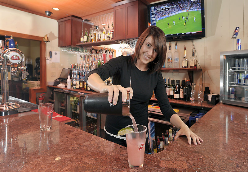 Bartender Amanda Churchill makes one of The Loft's X-Rated Margaritas using Jose Cuervo tequila, Triple Sec, Rose's lime juice and X-Rated Fusion Liquor, made from passion fruit, with a splash of sour mix.