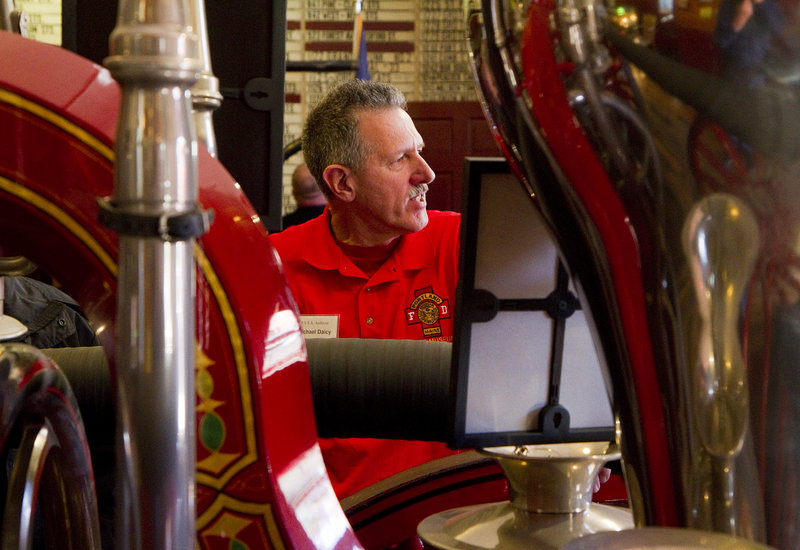 Michael Daicy, archivist for the Portland Veteran Firemen's Association, provides insight to visitors at the association's Spring Street museum on Saturday.