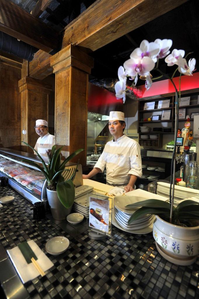 Seiji Ando, left, and Richie Akizaki work behind the sushi bar at Kushiya Benkay.