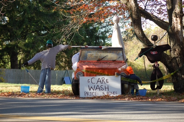 """At one Cape Elizabeth home, the cost of a """"Scare Wash"""" is """"3 Bones."""" Several towns around southern Maine have been holding scarecrow contests."""