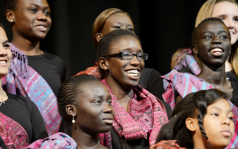 """Judith Abdalla, an immigrant from Sudan, prepares to perform """"Song for Malala"""" with the Pihcintu Multicultural Children's Chorus Wednesday at Portland High School's auditorium. Composed by songwriter Con Fullam, the song honors the Pakistani girl wounded by the Taliban and will be posted on YouTube with the hope of being an international sensation."""