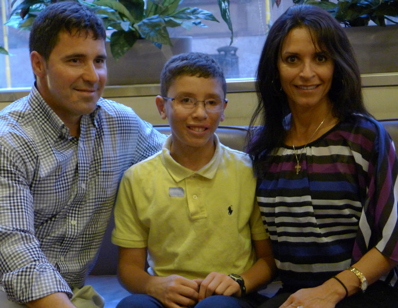 The Finkbonner family, from left, Donny, Jake and Elsa, are in Rome this week. Jake Finkbonner's recovery from a flesh-eating bacteria has been considered a miracle by the Catholic Church, which is canonizing St. Kateri, who is credited with helping his healing.
