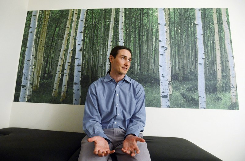 Dr. Dustin Sulak speaks with a reporter at his Falmouth practice. Sulak, an osteopath who also has a practice in Hallowell, has become known statewide for his willingness to certify patients for medical marijuana.