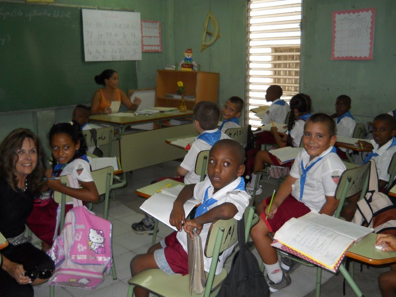 Cuban elementary school students react to a visitor.