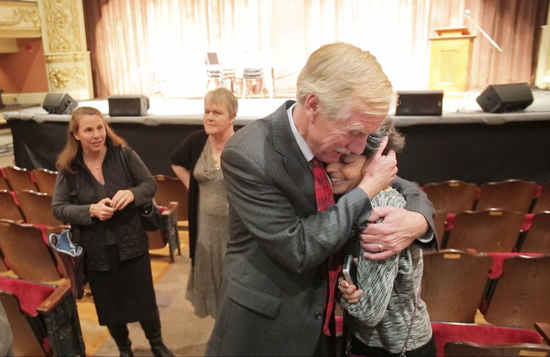Angus King hugs his wife, Mary Herman, after a candidate forum Oct. 23 at the Waterville Opera House. Mary Herman, who runs a consulting business, joins her husband for campaigning some days and also does solo appearances.