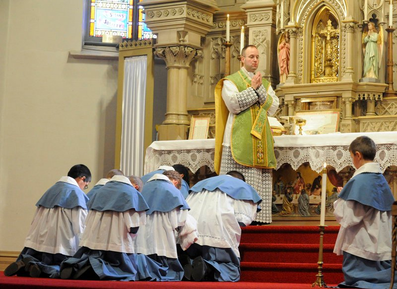 """The Rev. Canon Andreas Hellmann prays during a Latin Mass at a church in Manitowoc, Wis. In 2007 Pope Benedict XVI called it a """"precious treasure to be preserved."""""""