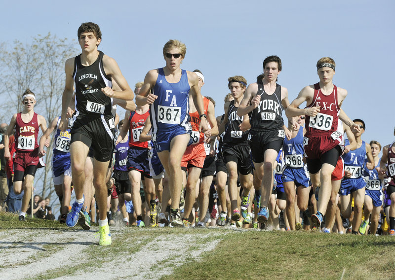Nick Smelcer of Lincoln Academy leads the pack early in the Class B boys' cross country championship race Saturday in Belfast. Dan Curts (336) of Ellsworth won the race, edging two-time champ Silas Eastman (367) of Fryeburg Academy by four-tenths of a second.