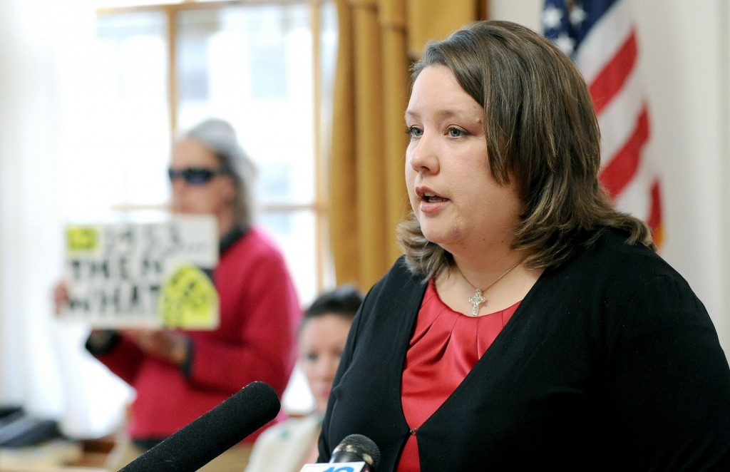With a lone protestor in background, Rep. Diane Russell holds a press conference in April 2011 at Portland City Hall to advocate legalizing and taxing marijuana. Russell is once again pushing for legalization, one week after voters in Colorado and Washington helped those states become the first to legalize recreational use of the drug.