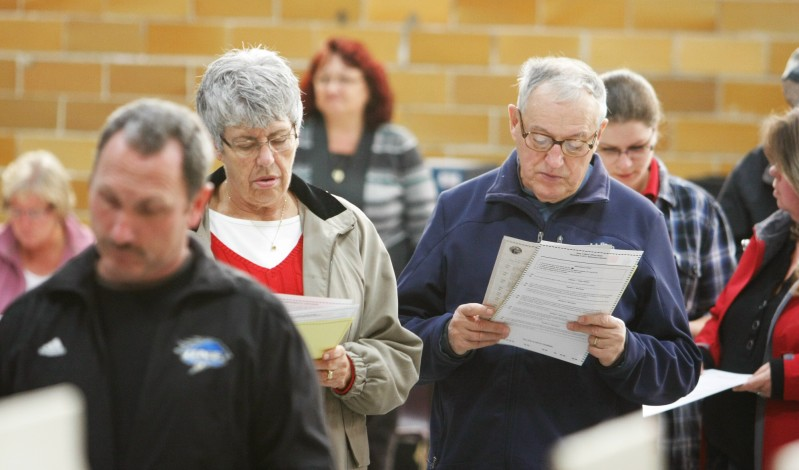 Doris and Julian Lambert look over their ballots while waiting in line to vote at the J. Richard Martin Community Center in Biddeford Tuesday, November 6, 2012. Jill Brady/Staff Photographer
