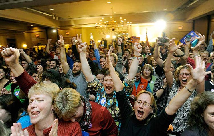 People celebrate at the Holiday Inn by the Bay in Portland after learning same-sex marriage in Maine had passed on Tuesday, November 6, 2012. Three weeks after voters backed same-sex marriage for the first time, the U.S. Supreme Court is deciding whether to take up the issue.