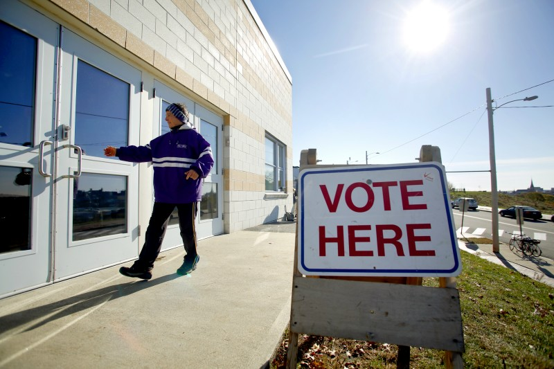 A voter enters the East End Elementary School in Portland on November 6, 2012. Tim Greenway/Staff Photographer