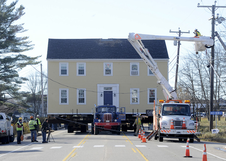 The historic Storer Garrison House is moved several hundred yards along Route 1 in Wells Friday to its new home at Mike's Clam Shack owned by Michael McDermott.