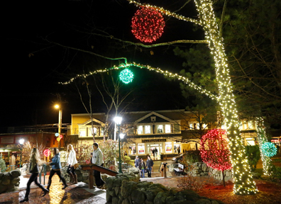 Shoppers roam through the LL Bean campus on Friday after many of the stores in Freeport opened for business at midnight.