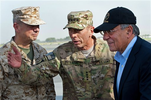 FILE POOL - In this July 9, 2011 file photo, USMC Gen. John Allen, left, and Army Gen. David Petraeus, top U.S. commander in Afghanistan and incoming CIA Director, greet former CIA Director and new U.S. Defense Secretary Leon Panetta, right, as he lands in Kabul, Afghanistan, Saturday, July 9, 2011. (AP Photo/Paul J. Richards, Pool)