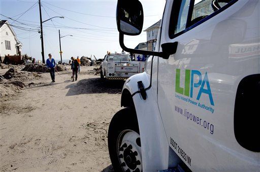 A Long Island Power Authority (LIPA) truck is seen in the Belle Harbor neighborhood of the borough of Queens, New York, Monday, Nov.12, 2012, in the wake of Superstorm Sandy. More than 70,000 customers of Long Island Power Authority in New York were without electricity Monday, two weeks after Superstorm Sandy struck. (AP Photo/Craig Ruttle)