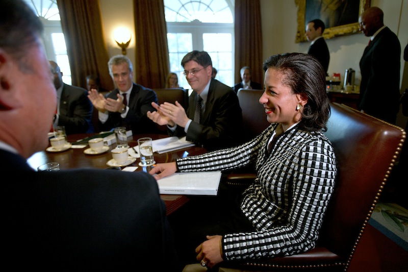 UN Ambassador Susan Rice, right, smiles as she is applauded, as President Barack Obama says what an excellent job she has been doing, before meeting with his cabinet, Wednesday, Nov. 28, 2012, in the Cabinet Room of the White House in Washington. Earlier, Rice continued her fight on Capitol Hill to win over skeptics in the Senate who could block her chances at becoming the next U.S. secretary of state. Republican lawmakers said they were even more troubled after face-to-face meetings with her over the handling of the Sept. 11 deadly attack on the U.S. Consulate in Benghazi, Libya. (AP Photo/Jacquelyn Martin)