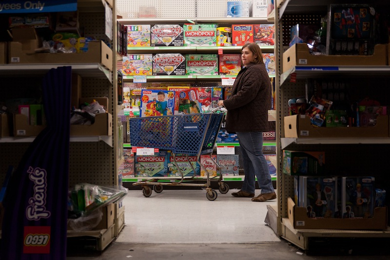A customer examines shelves of toys during Toys