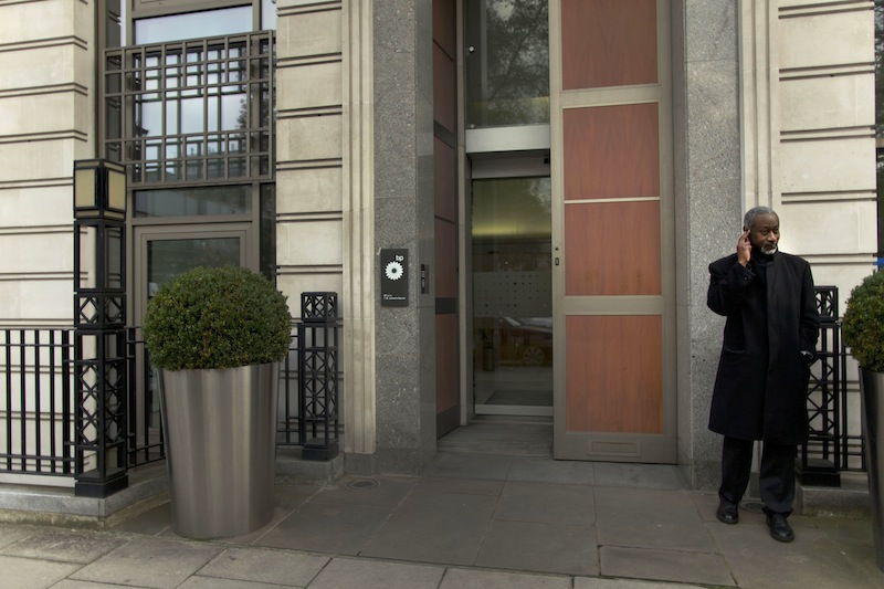 A security man stands guard outside the headquarters building of British oil company BP in London, Thursday, Nov. 15, 2012. BP said Thursday it is in advanced talks with U.S. agencies about settling criminal and other claims from the Gulf of Mexico well blowout two years ago. The explosion and fire aboard the Deepwater Horizon rig on April 20, 2010, killed 11 workers and set off a spill which continued for 87 days, fouling large areas of the southern coast of the United States. (AP Photo/Matt Dunham)