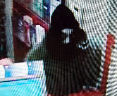 A video surveillance image shows the man police say robbed the Capitol Street CVS pharmacy in Augusta Wednesday afternoon.