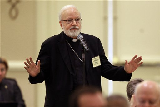 Cardinal Sean O'Malley, of Boston, asks a question during a discussion at the United States Conference of Catholic Bishops' annual fall meeting in Baltimore Monday.