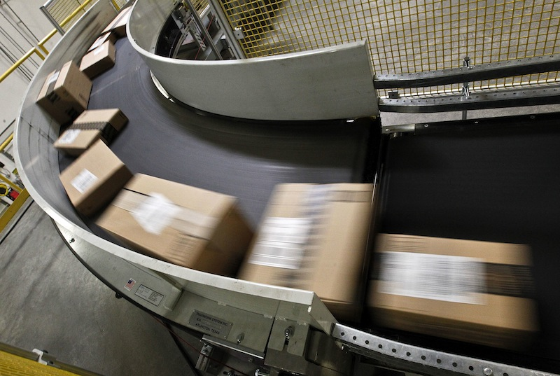 Packages ready to ship move along a conveyor belt at the Amazon.com 1.2 million square foot fulfillment center Monday, Nov. 26, 2012, in Phoenix. Americans clicked away on their computers and smartphones for deals on Cyber Monday, which is expected to be the biggest online shopping day in history. (AP Photo/Ross D. Franklin)