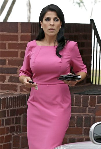 Jill Kelley leaves her home in Tampa, Fla., on Nov. 13. The scandal this week cost Kelley her appointment as an honorary consul for the South Korean government, which she had gotten because of her friendship with Gen. David Petraeus. The Koreans said she had misused the title in her personal business dealings.