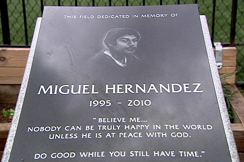 "The headstone of Miguel ""Mickey"" Hernandez, who died of a stab wound to the chest in November 2010 at age 15. Ronald Ramos, above, one of Hernandez's friends, says gangs prowled the neighborhoods and their members were also in the schools."