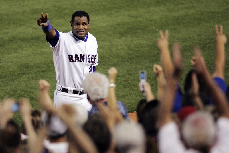 In this June 20, 2007, file photo, Texas Rangers' Sammy Sosa acknowledges cheers from fans after hitting his 600th career home run against the Chicago Cubs in a baseball game in Arlington, Texas. Sosa, Roger Clemens and Barry Bonds are set to show up on the Hall of Fame ballot for the first time on Wednesday, Nov. 28, 2012, and fans will soon find out whether drug allegations block the former stars from reaching baseball's shrine. (AP Photo/Tim Sharp, File)