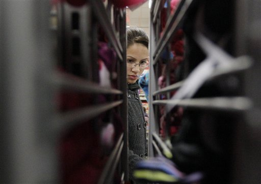 A customer shops at a K-Mart in Chicago. If the economic downturn has taught retailers anything, it's that a 50 percent off sale isn't enough to lure finicky American shoppers into stores these days