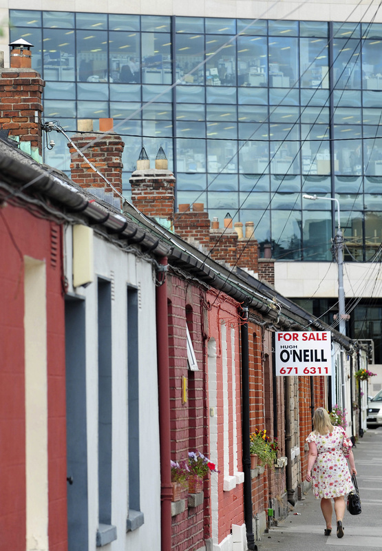 """A row of cottages in Dublin in 2011. """"I'm not calling any massive recovery, but people are going to look back and see a lot of missed opportunities in Ireland if they had the cash,"""" says the head of one property broker."""