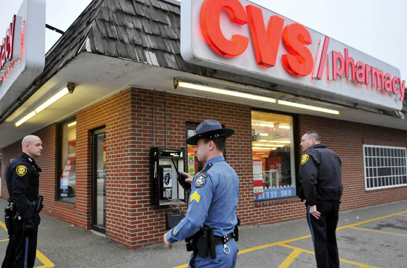 Augusta and state police surround the CVS pharmacy on Capitol Street in Augusta on Wednesday, after the store was robbed of narcotics. Police tracked the suspect with a dog.
