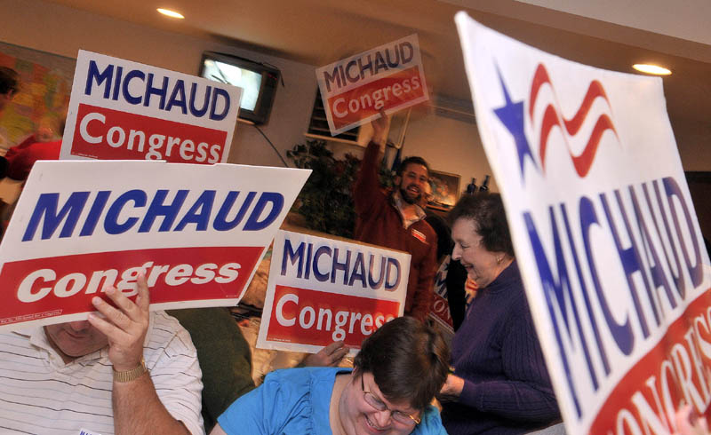 Mike Michaud supporters cheer in East Millinocket on Tuesday.