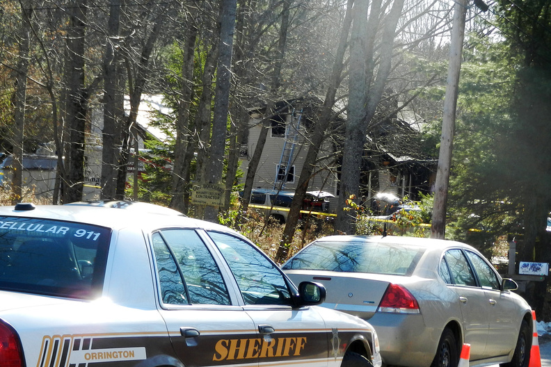 Authorities converge at a home where a fire killed four people on Dow Road in Orrington on Saturday.