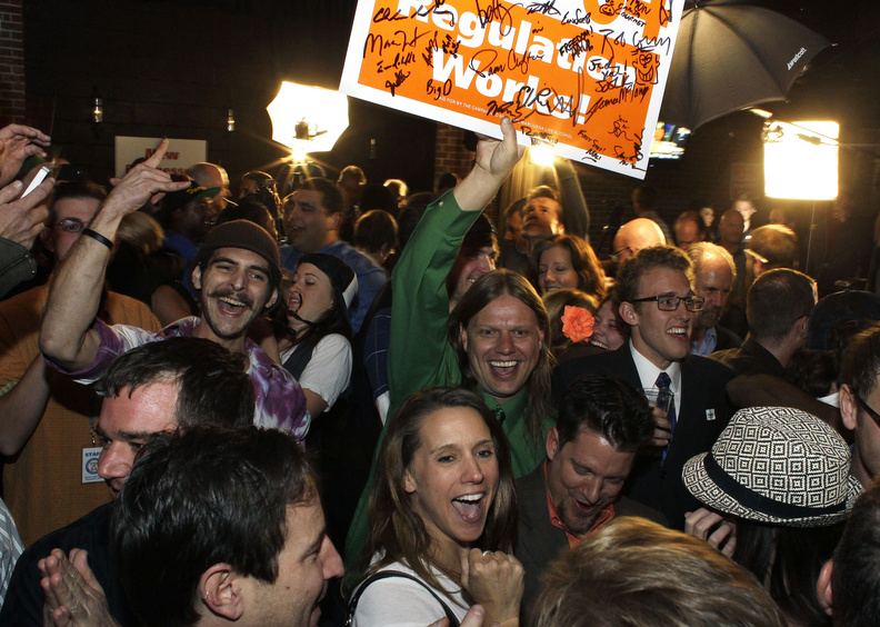 Supporters in Denver celebrate the victory of an amendment that legalizes marijuana use in Colorado on Tuesday night.