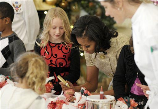 First lady Michelle Obama decorates a lollipop during a holiday decoration preview at the White House on Wednesday.
