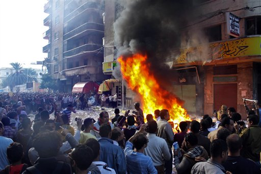 Protesters storm an office of Egyptian President Mohammed Morsi's Muslim Brotherhood Freedom and Justice party and set fires in the Mediterranean port city of Alexandria, Egypt on Friday. State TV says Morsi opponents also set fire to his party's offices in the Suez Canal cities of Suez, Port Said and Ismailia.