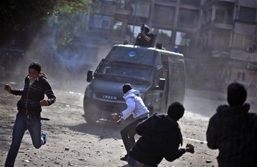 Egyptian protesters clash with security forces near Tahrir Square in Cairo on Wednesday.