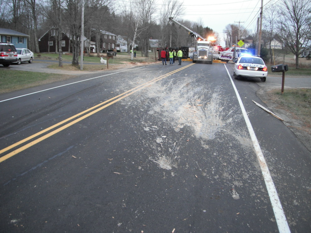 About 15 cubic yards of a mix of waste raw chicken parts and processed chicken in liquid discharged from a truck that rolled over in Gorham on Tuesday, Nov. 27, 2012. The waste landed on the roadway, residential lawns and driveways.