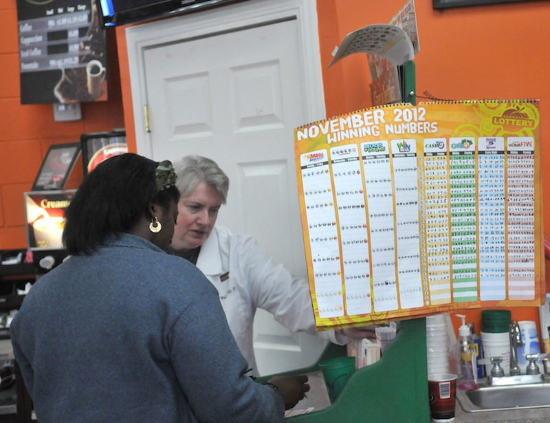 Shoppers fill out forms to purchase lottery tickets Tuesday afternoon at the Shell Station on Chatham Parkway in Savannah, Ga. Powerball ticket slaes have been brisk and the jackpot has risen to $500 Million.