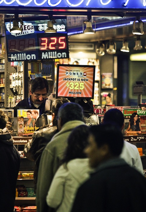 People wait in line to purchase lottery on Friday, Nov. 23, 2012 in New York. The jackpot for Powerball's weekend drawing has climbed to $325 million, the fourth-largest in the game's history. Powerball organizers say this is the first run-up to a large jackpot that's fallen over a major holiday. (AP Photo/Bebeto Matthews)