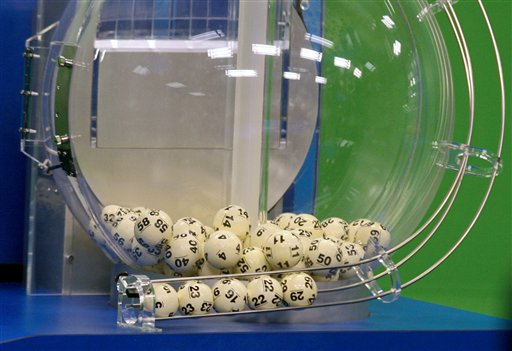 Powerball numbers are chosen in the drawing at the Florida Lottery on Wednesday in Tallahassee, Fla. The numbers drawn in the $579.9 million game were: 5, 16, 22, 23, 29 and Powerball of 6.